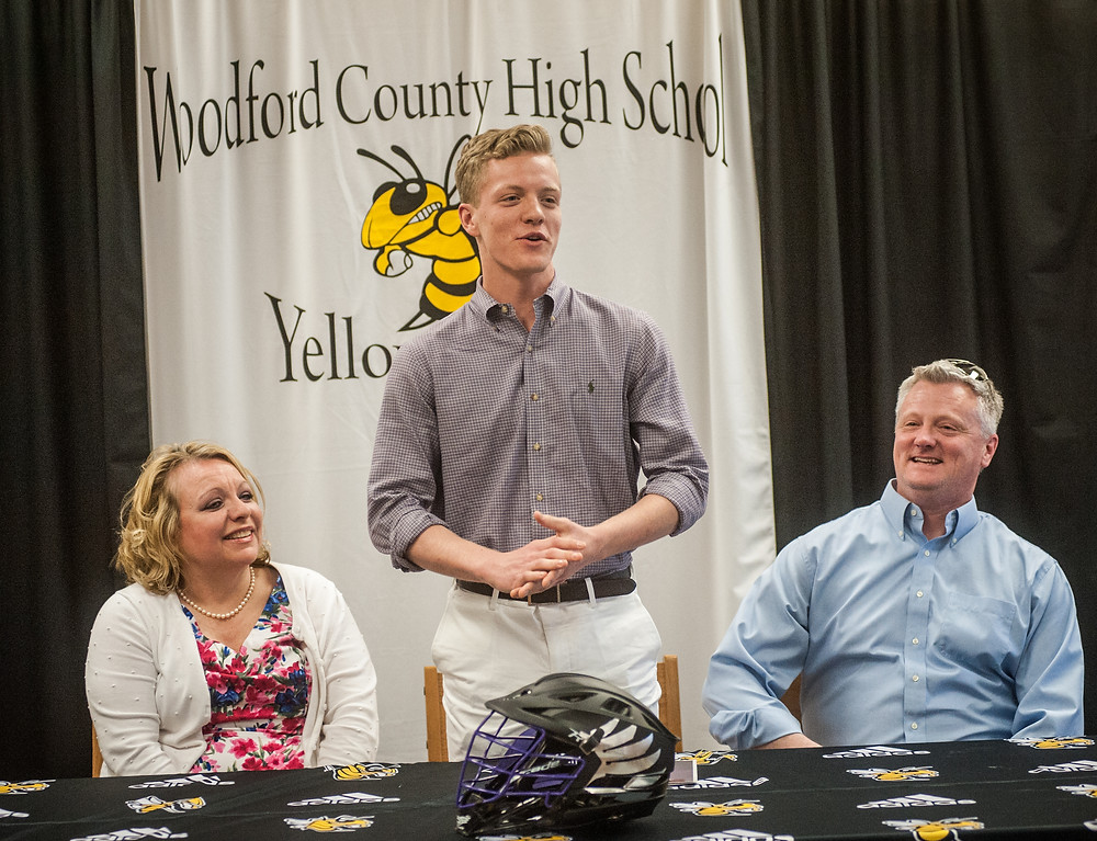 WCHS SENIOR TREVOR WELCH signed a letter of intent to play lacrosse for  Asbury University on Thursday, April 12. Pictured from left, are his mother Amy Pierce Welch, Trevor and his father Trevor Sr.  (Photo by Bill Caine)
