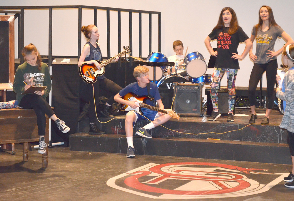 'SCHOOL OF ROCK' will come to the Woodford Theatre for three performances beginning Friday, June 24, at 7:30 p.m. From left are Vivien Kurtz, Sophie Hill, Will Shivley, Kyle Reed, Bella Mancuso, Jaid Goh and Annie Harris during a recent rehearsal of the stage musical. (Photo by Bob Vlach)