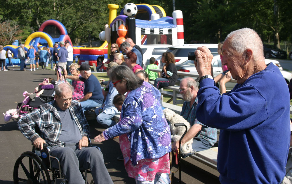 MILLVILLE HISTORIAN Jake Jacobs, 88, right, kept busy videotaping highlights of Saturday's 37th annual Hillbilly Daze in Millville. (Photo by John McGary)