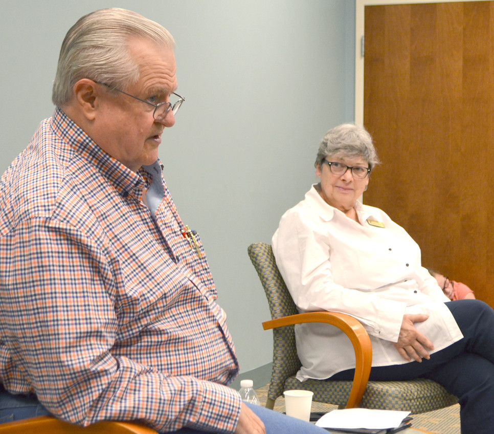 GERI ISAACS listened to Charlie Beagle during a Friday Coffee Club at the Woodford County Library last August. The twice-weekly program stimulates conversation on many different topics. Beagle, a security officer at the Woodford County Courthouse, shared stories about his 30 years as a federal correctional officer. (File photo by Bob Vlach)