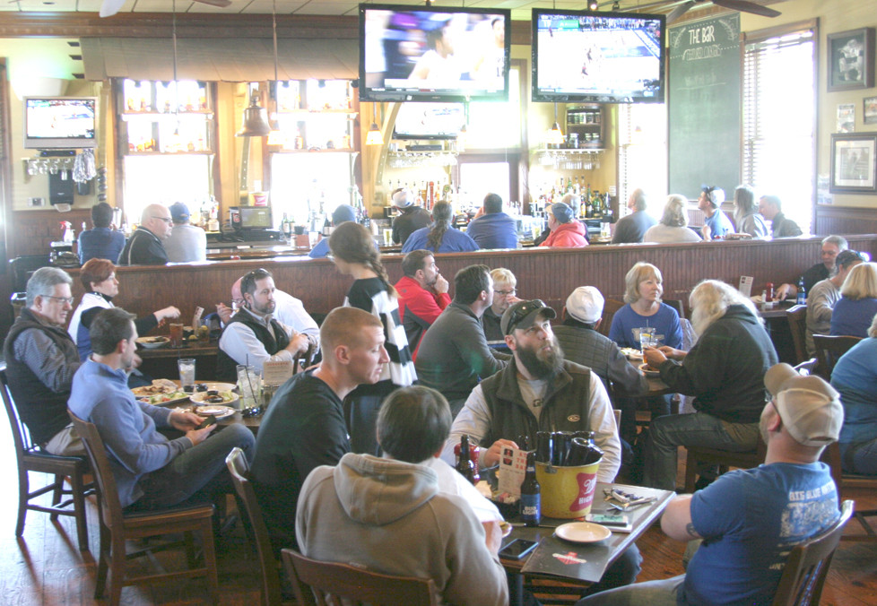 BUSINESS WAS BOOMING at Ricardo's Friday, March 10, when customers packed the Frankfort Street restaurant to watch UK beat Georgia. (Photo by John McGary)