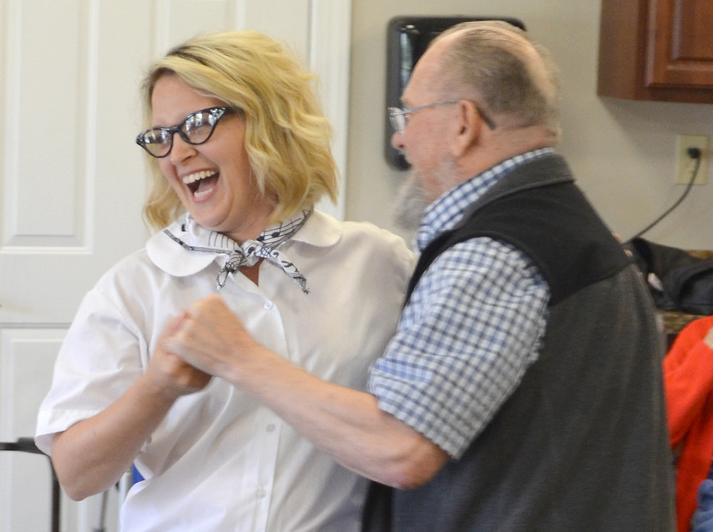 "LAURIE DOROUGH, executive director of Daisy Hill Senior Living, shared a laugh and a dance with resident Ted Collins during a ""Sock Hop"" on Friday afternoon, Sept. 15. (Photo by Bob Vlach)"