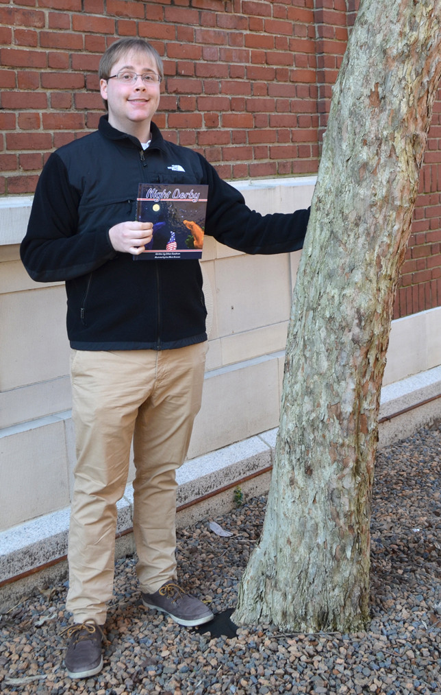 """ETHAN GOODRUM, who graduated from Woodford County High School in 2011, has written """"Night Derby,"""" a children's book. The aspiring novelist has """"a long very list"""" of titles that influenced him to stretch his imagination as a writer. (Photo by Bob Vlach)"""
