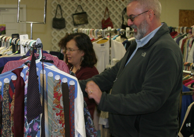 JOURNEY CHURCH Discipleship Pastor Tony Hardin, right, and Journey Provisions Director Heather Nichols take a look at some of the clothing that will be available when the church's new thrift shop opens Jan. 3. (Photo by John McGary)
