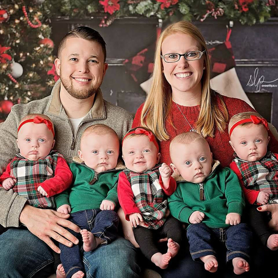 """JORDAN AND BRIANA DRISKELL posed Sunday with their quintuplets, from left, Zoey, Asher, Dakota, Gavin and Hollyn. Of her difficult pregnancy and the problems posed by their premature births, Briana said, """"They're miracles from God, that's for sure."""" (Photo courtesy Sweetlilpics by Ashley Childress)"""