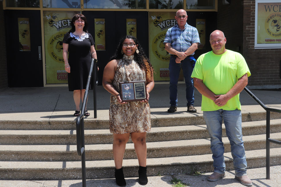 """MAQUOIA BERNABE was presented with the Michael Jackson """"Trailblazer"""" Award July 10. Pictured from left are Debbie Jackson, Bernabe, Randy Cotton and Coach Brent Courtney. (Photo by Thomas Mims)"""