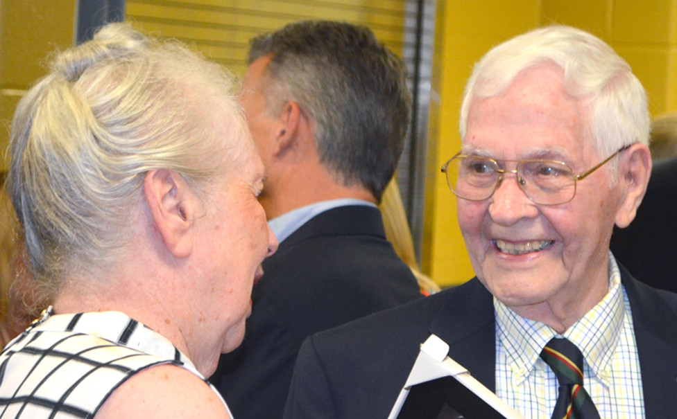 LONGTIME WOODFORD SUN managing editor Moss Vance spoke with former second grade teacher Peggy Carter Seal prior to his induction into the Woodford County Public Schools Hall of Fame Saturday. More photos of the inductees on p. 8. (Photo by Bob Vlach)