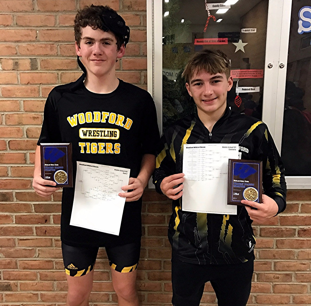 WILL SMITHERS, left, and JONATHAN PITTMAN won their weight classes for the Woodford County Middle School wrestling team in the Woodland Wildcat Classic tournament in Taylor Mill on Saturday, Dec. 3. Smithers won the 152-pound weight class, while Pittman won the 121-pound weight class. (Photos submitted)