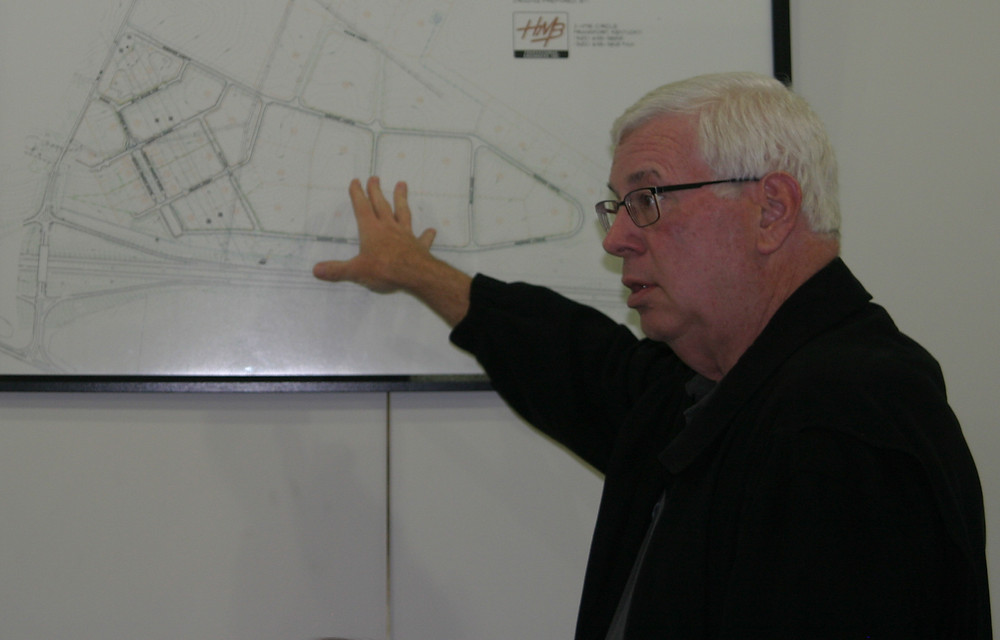 EDA CHAIR John Soper showed the Midway City Council Monday the 103-plus acres in the southeast portion of Midway Station where developer Dennis Anderson has decided not to build homes. (Photo by John McGary)