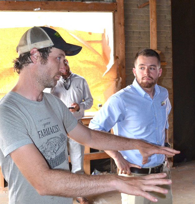 JESSE FROST, who will serve as executive chef at Spark Community Café, left, talked about plans for the restaurant's kitchen space while Tristan Ferrell looks on. (Photo by Bob Vlach)