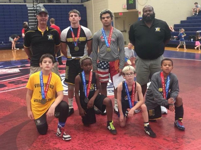 WOODFORD WRESTLING CLUB won 12 gold medals, (16 total) in the Alabama State Games June 9. Front are , Jeffrey Temprano, Nikko Strong-Walker, Brycen Gray, and Braylen Livingston; back, Coach Mike Andreoni, Wyatt Andreoni, Triston Brooks and Coach Jarvis Livingston. (Photo submitted)