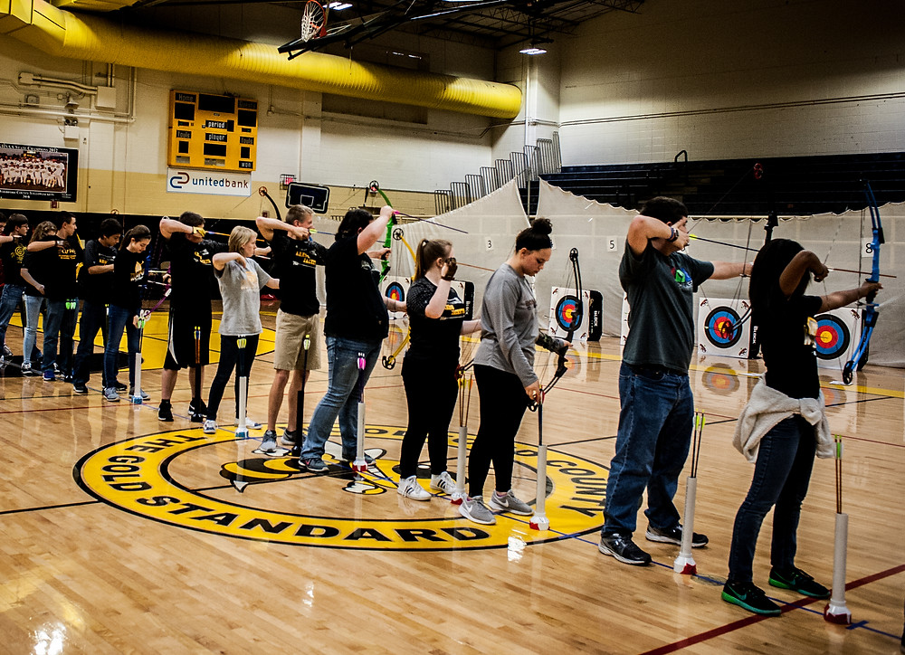 THE WOODFORD COUNTY ARCHERY CLUB competed in the 2nd Annual Joe Girouard Sr. Memorial Tournament on Saturday Nov 11 at Woodford County High School. (Photo by Bill Caine)
