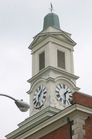 THE CLOCK TOWER atop the Woodford County Courthouse, which was dedicated in 1970, has seen far better days. County Maintenance Superintendent Rick Wade said he expects work on the clock tower, roof, gutters and quoins of the building to begin June 26 and take 16 weeks to complete. (Photo by John McGary)