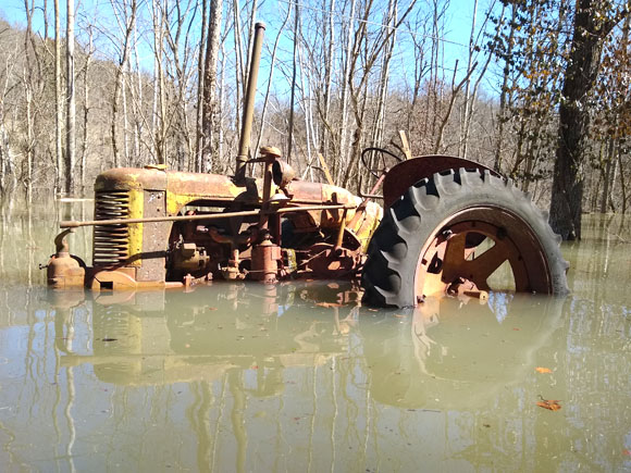 Antique tractor in water