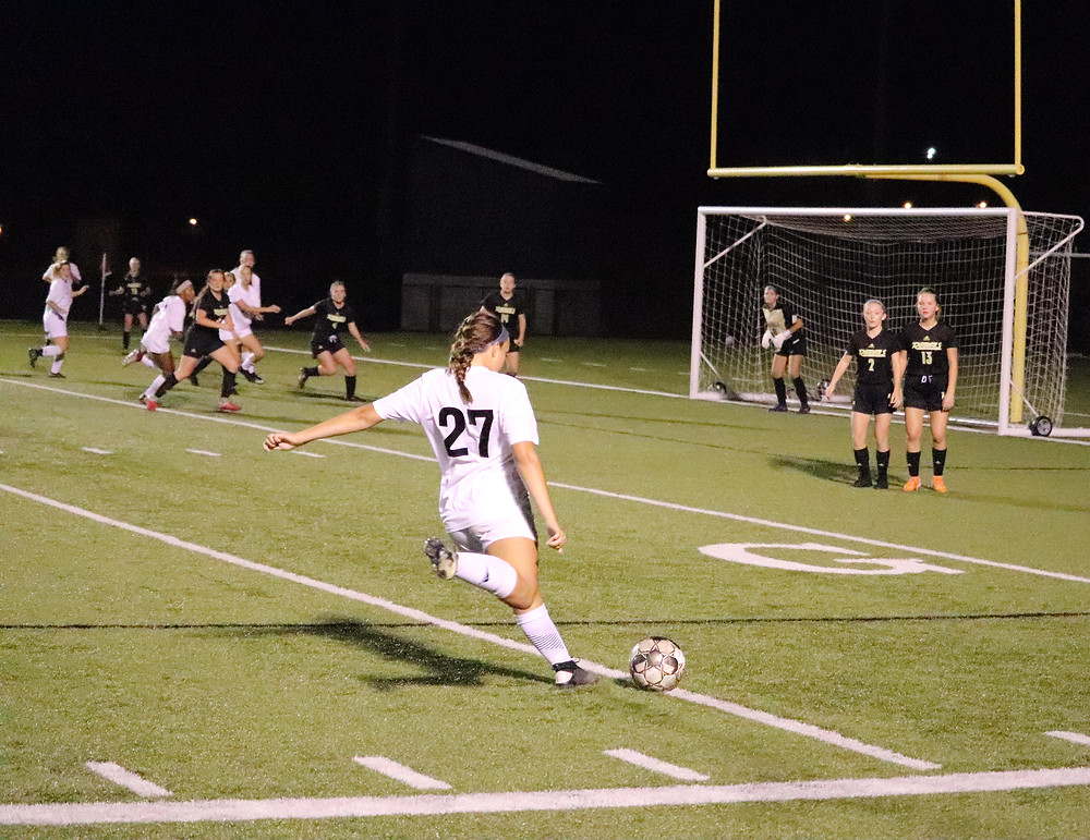EMMA OBERLANDER LETS IT RIP on a free kick late in Woodford County's 1-0 loss to Boyle County. The senior leads the Lady Yellow Jackets with seven assists in 2019, but was unable to find a teammate for a game-tying goal on this kick. (Photo by Thomas Mims)