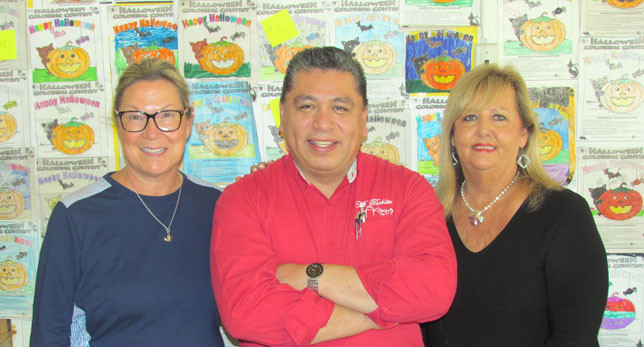 WOODFORD SUN Halloween coloring contest judges paused for a photo Monday afternoon at the Sun after performing their important duties. From left, Robin Reed of the Cornerstone Pharmacy, Froy Lopez of Mi Pueblito, and Cindy Shryock of Rector Hayden Realtors. Many thanks to the judges and to all the children who took part in this year's contest. (Photo by John McGary)