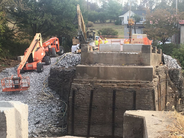 THE WEISENBERGER MILL BRIDGE replacement project is expected to be finished next May. This Sept. 30 photo shows strengthening work on the Woodford and Scott County sides of the bridge. (Photo by Vanessa Seitz)