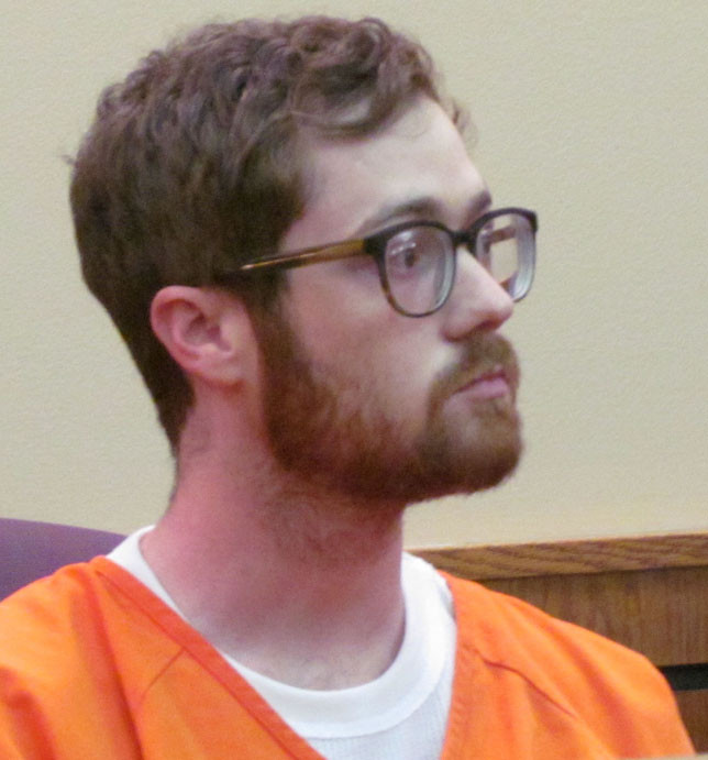 KENNETH DOUG MCDANIEL III pleaded not guilty in Woodford District Court for his alleged Oct. 6 attack on his wife, Katy. After hearing from his attorney, County Attorney Alan George and a physician who spoke of the nature of her wounds, Judge Mary Jane Phelps – who married the McDaniels – raised his bond to $250,000 full cash. (Photo by John McGary)