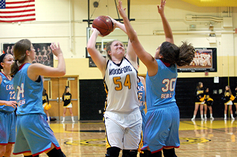 DELANEY ENLOW set two new rebounding records for the Woodford County High School girl's basketball team. (Photo by Rick Capone)