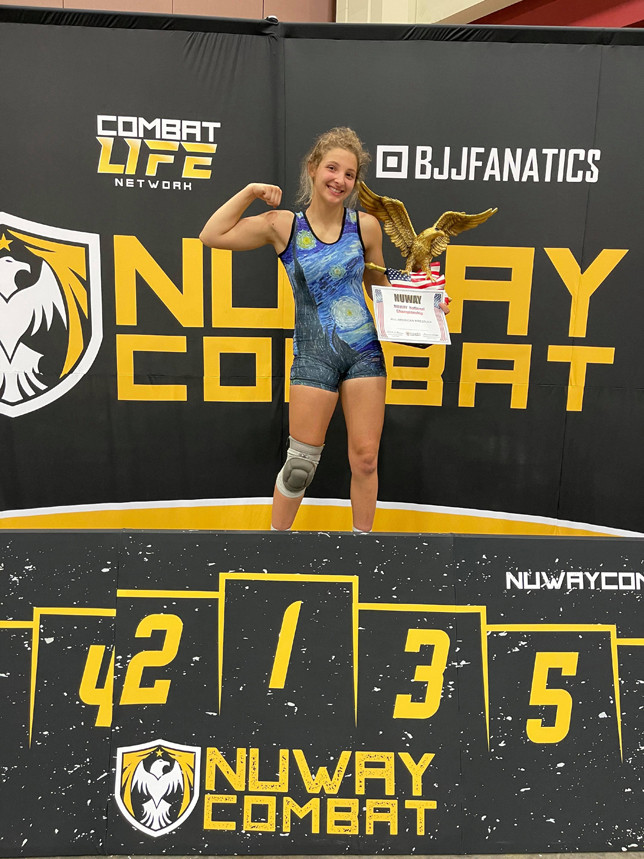 KAYLEN ESCALONI poses with her All-American trophy at the Nuway National tournament June 4. (Photo submitted)