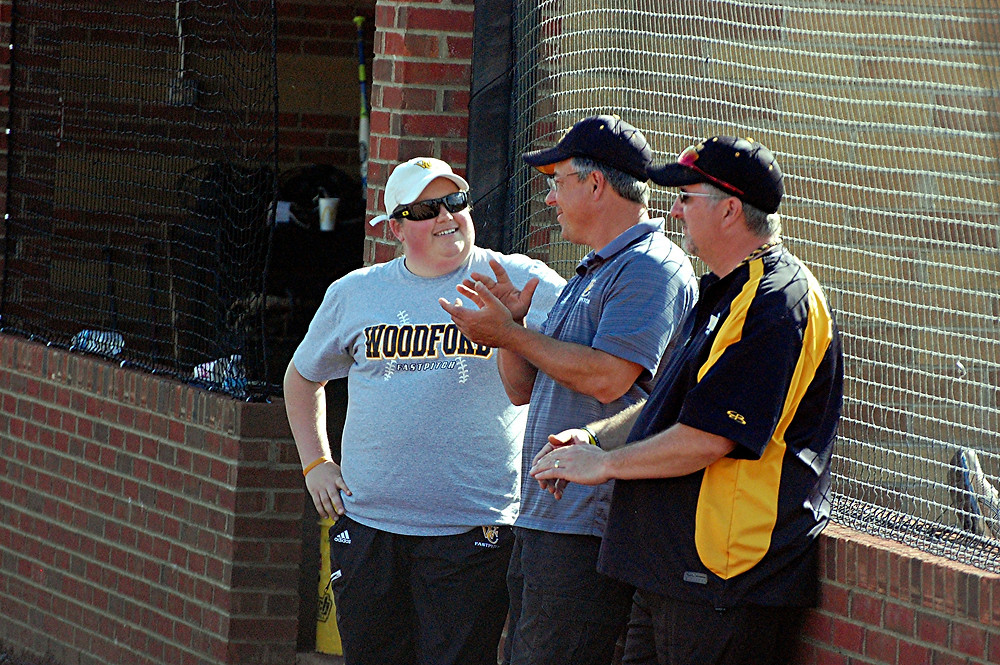 FORMER Woodford County High School softball coach Sasha Turansky, left, enjoys a laugh with her assistant coaches, Les Anderson, middle, and Rick Abel, right, before a regular season game last year. Turansky resigned her position at the end of the 2016 season. Turansky resigned her post as WCHS head coach following the 2016 season. In her four years with Woodford, she compiled a 109-30-1 overall record, two 41st District titles and three appearances in the 11th Region championship game. (Photo by Rick Capone)