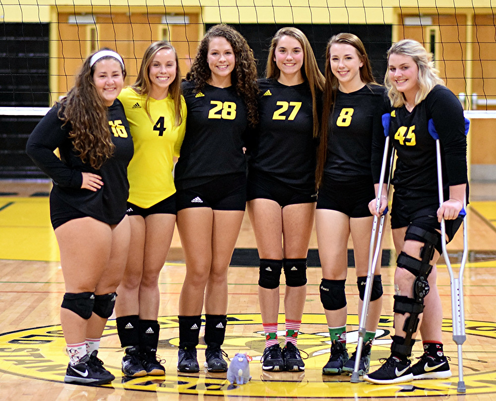 SENIORS HONORED. On Thursday, Oct. 13, prior to its 3-0 win over East Jessamine, the Woodford County High School volleyball team honored its seniors in a short ceremony in front of family, friends and fans. The seniors are, from left, Sophie Adams, Mary Crutchfield, Caleigh Evans, Cheyenne Barrier, Ashlyn Chumley and Kennedy Morgan. (Photo by Chris Holbrook)