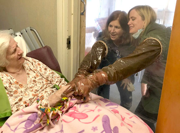 PAT MATTHEWS held her daughters, Betsy Anderson, left, and Sarah Turner, by the hand for the first time in about eight months. In-person visits are not allowed at Taylor Manor and other long-term care facilities to help prevent nursing home residents from contracting COVID-19 in the midst of the pandemic. (Photo submitted)