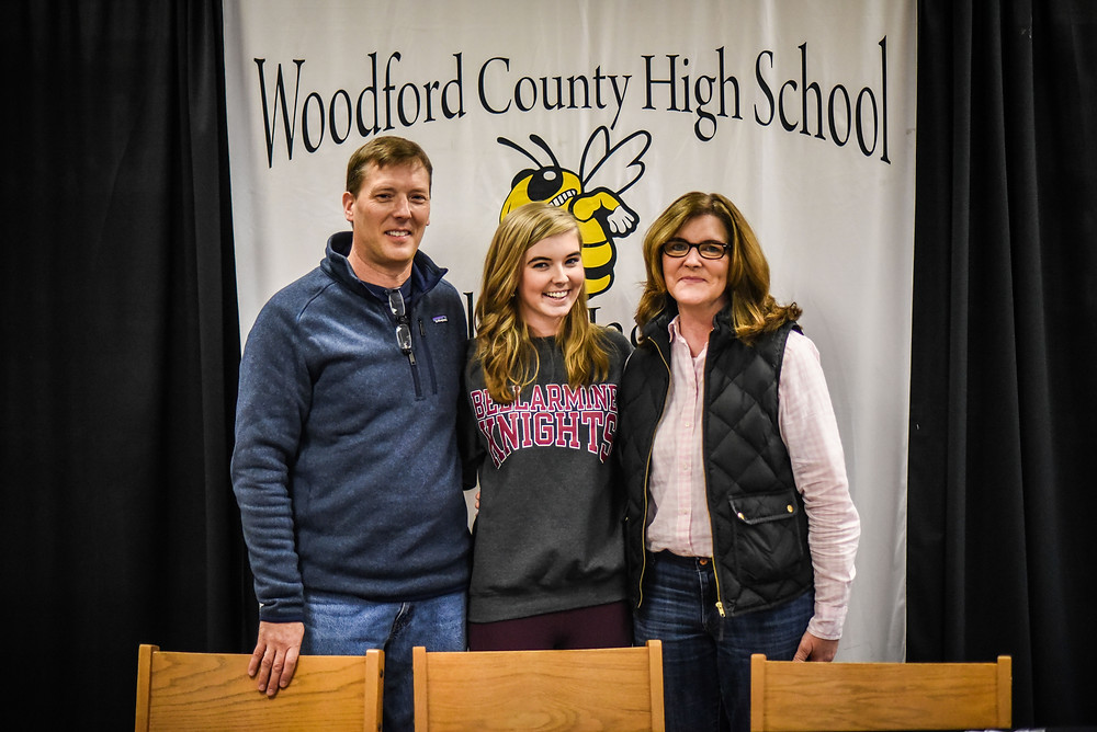 WCHS SENIOR ADDISON BECK signed her letter of intent with Bellarmine University Friday, Jan. 11. She's pictured with her dad, Dave Beck, and mom Dena Beck.  (Photo by Bill Caine)