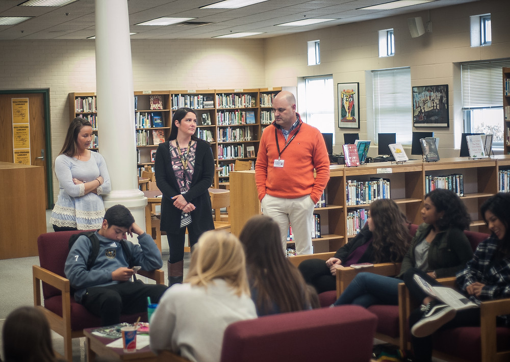 WCHS PRINCIPAL ROB AKERS introduced new girls' soccer coach Sara Thornton at a players meeting on Monday, March 26 in the WCHS library. Thornton , a 2001 WCHS grad, named Megan Poage as her assistant coach. Thornton is a teacher at Simmons elementary school. (Photo by Bill Caine)