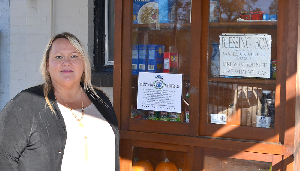 A BLESSING BOX in downtown Versailles helped Sherry Williams realize how many homeless people live in her community. Williams said she has created a nonprofit to raise money in order to open a homeless shelter here. She dedicated this blessing box to the memory of her father, James Coburn, a Vietnam War veteran. (Photo by Bob Vlach)