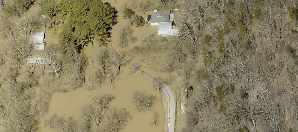 AERIAL PHOTOGRAPHS, like this of the Shoreacres area, helped officials make a successful case for Woodford County being added to the list of those eligible for individual assistance for losses suffered in the February and March flooding along the Kentucky River. (Photo by Eagle View)