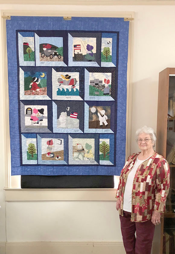 SHARON BLOOM presented a 20th Century Sunbonnet Sue patterned quilt to the Woodford County Historical Society. (Photo submitted)
