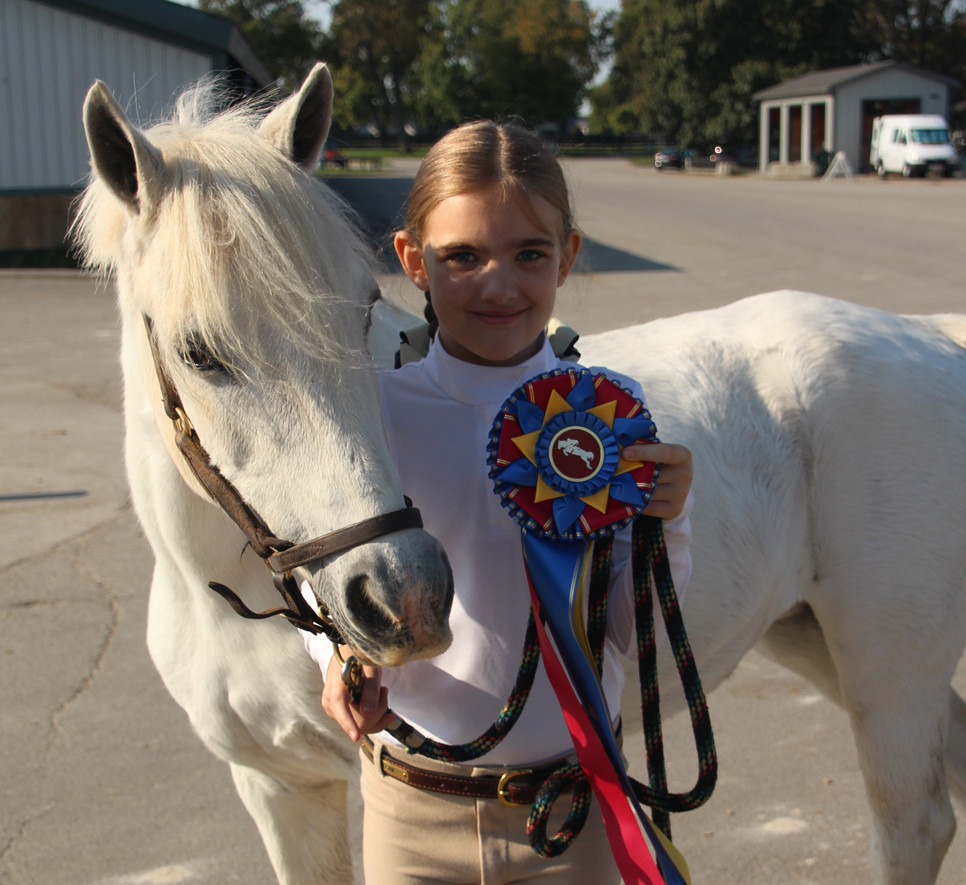 ANNA PHELAN poses with horse Rockdale's Fable after winning the champion ribbon in the walk/trot division at the KHJA Fall Classic Sept. 16 and 17 at the Kentucky Horse Park. (Photo submitted)