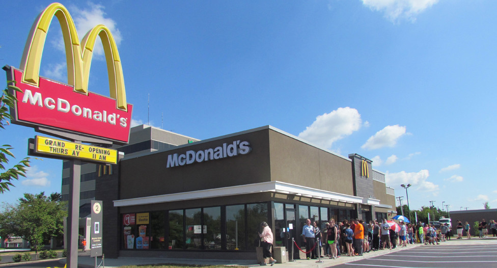 A LITTLE BEFORE Thursday's grand reopening of the McDonald's on United Drive, a large crowd waited to get inside. The first hundred were given coupons for free french fries every week for a year. (Photo by John McGary)