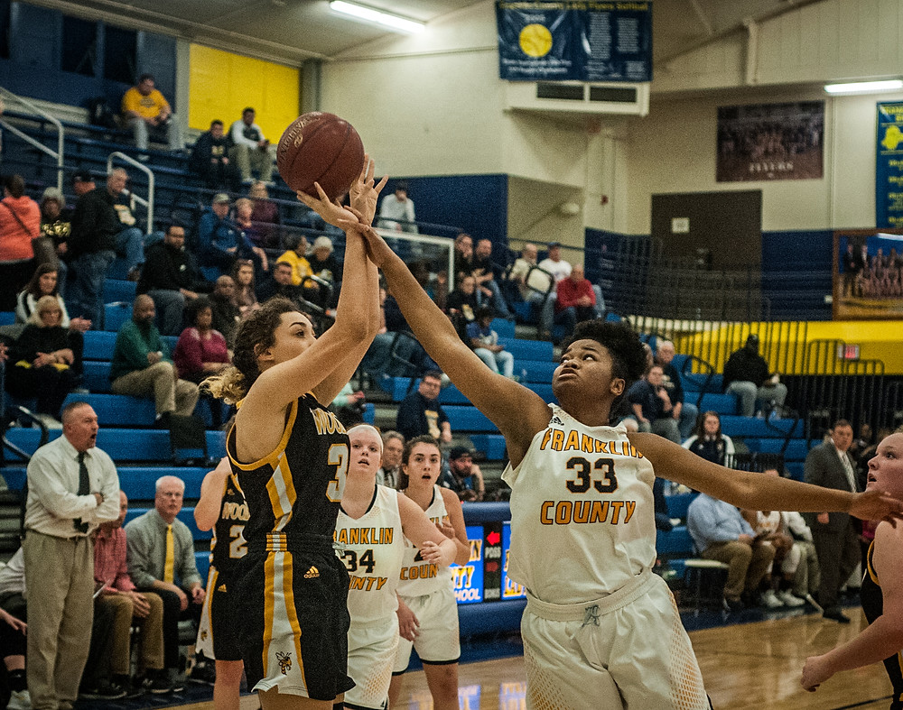 WCHS FRESHMAN DEVAN CHAMPION shoots over a Lady Flyer defender in a district game on Jan. 11 at Franklin County High School. (Photo by Bill Caine)