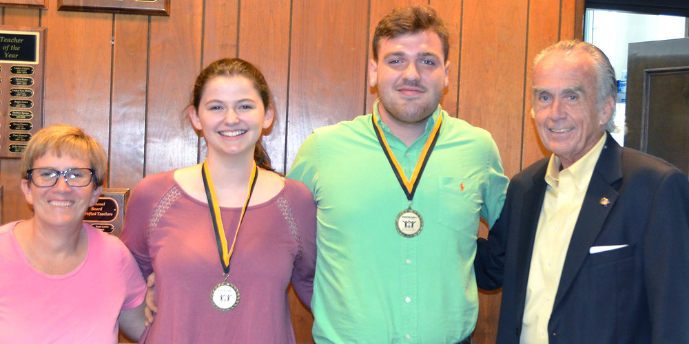 MAKENNA HENEHAN and Sam Smarr shared some of their experiences at the Governor's School for the Arts during the Woodford County Board of Education meeting on Monday, Aug. 28. From left are board member Karen Brock, Makenna, Sam and board Chair Ambrose Wilson IV. (Photo by Bob Vlach)