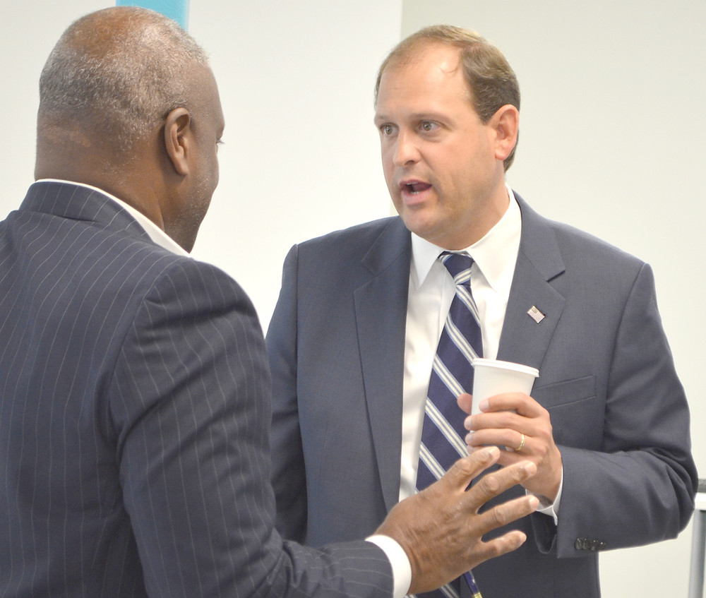 ANDY BARR, who represents Kentucky's 6th congressional district in the House of Representatives, spoke with those attending a Woodford County Chamber of Commerce breakfast at Ruggles Sign Company on Tuesday morning. Pictured with Barr is William Saunders. (Photo by Bob Vlach)