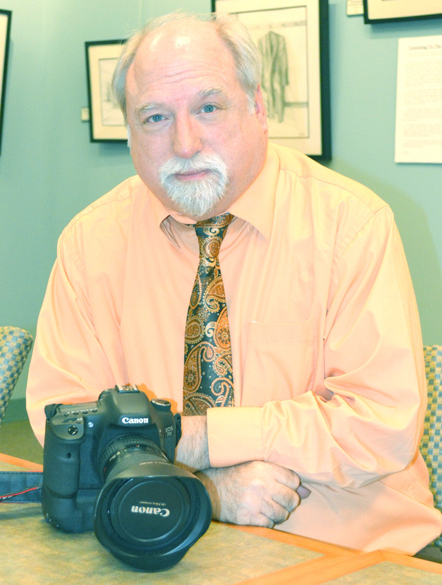 "BUD KRAFT covered ""spot news"" - structure fires and car wrecks - during his career as a photojournalist. He also had opportunities to document an array of human interest stories with his images. Over the last 10 years as staff photographer for the Kentucky Legislative Research Commission, Kraft has been documenting the happenings of the General Assembly. (Photo by Bob Vlach)"