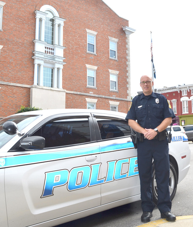 PATRICK SHRYOCK says he wants to make a difference as the Versailles Police Department's new community resource officer. The Woodford County native and his wife, Mary, have three daughters. His father, Nickie, was also a Versailles Police officer. (Photo by Bob Vlach)