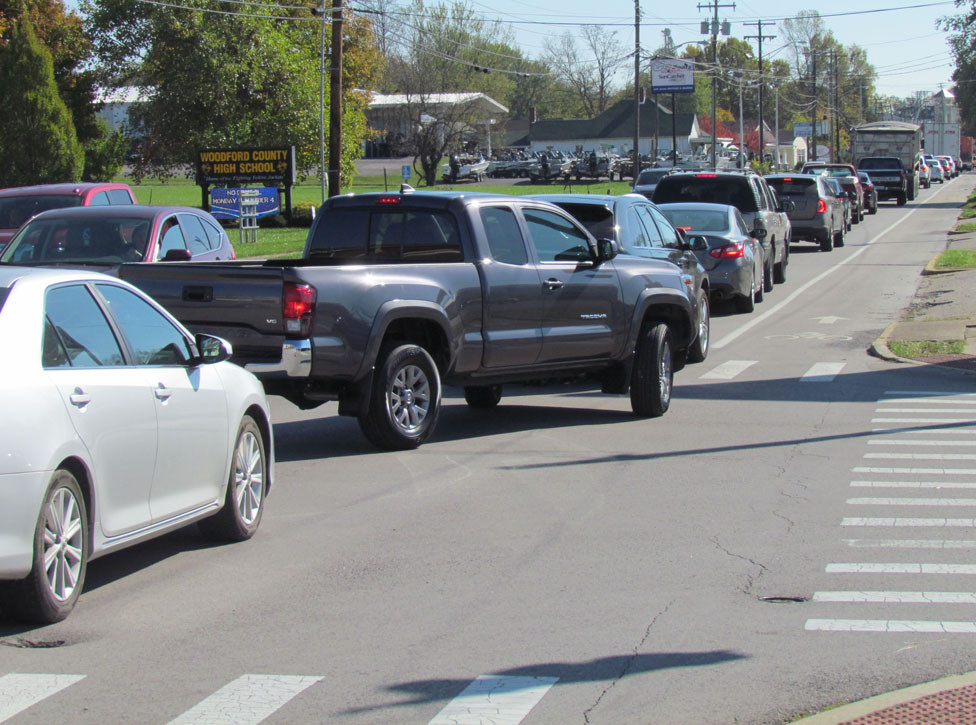LEXINGTON STREET TRAFFIC was backed up beginning last Friday at 9 a.m. as a result of railroad track and crossing maintenance by the R.J. Corman Railroad Group. This photo was taken about 45 minutes before Woodford County High School let out Friday. (Photo by John McGary)