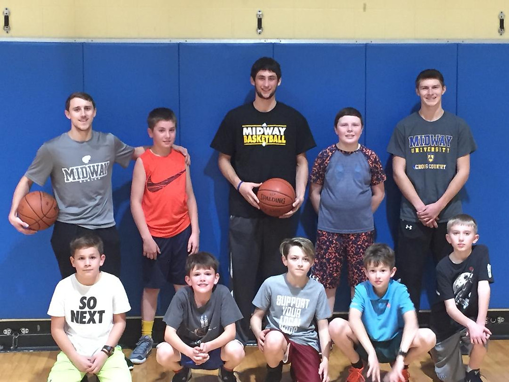 THREE MIDWAY UNIVERISTY BASKETBALL PLAYERS stopped by a local recreational team's practice on Dec. 4 and worked with the young players on fundamentals and made a big impression on the kids. From left, seated are: Wyatt Crowe, Cameron Irvin, Lane Stephenson, Wesley Schanbacher, Landon Sears. Back from left : Midway University freshman Logan Stafford, Louis Griese, Midway University freshman Travis Hensley, Owen Wingo, Midway University freshman Dylan Simpson.Not pictured are the Kings coaching staff, Brandon Sears, Jonathan Stafford and player Ryan Hendrix. (Photo Submitted)
