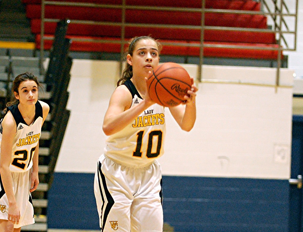 Peyton Rose, shown in a previous game, put up some good numbers in the Woodford County High School girls' basketball team's first game in the Community Trust Bank Invitational at Western Hills on Tuesday, Dec. 29. The sophomore point-guard had seven points, five steals and five assists in the Lady Jackets' 54-34 win over Ballard. (Photo by Rick Capone)