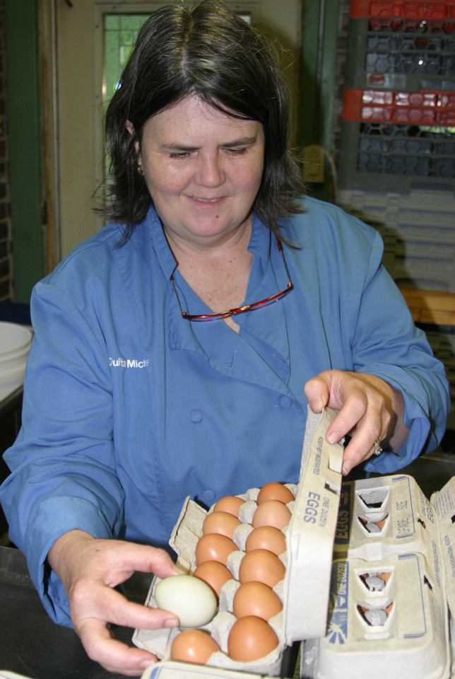 OUITA MICHEL, chef and owner/operator of seven Central Kentucky restaurants, may be nationally known for her culinary art, but even she couldn't explain why one egg was white and the other 11 were brown. (Photo by John McGary)