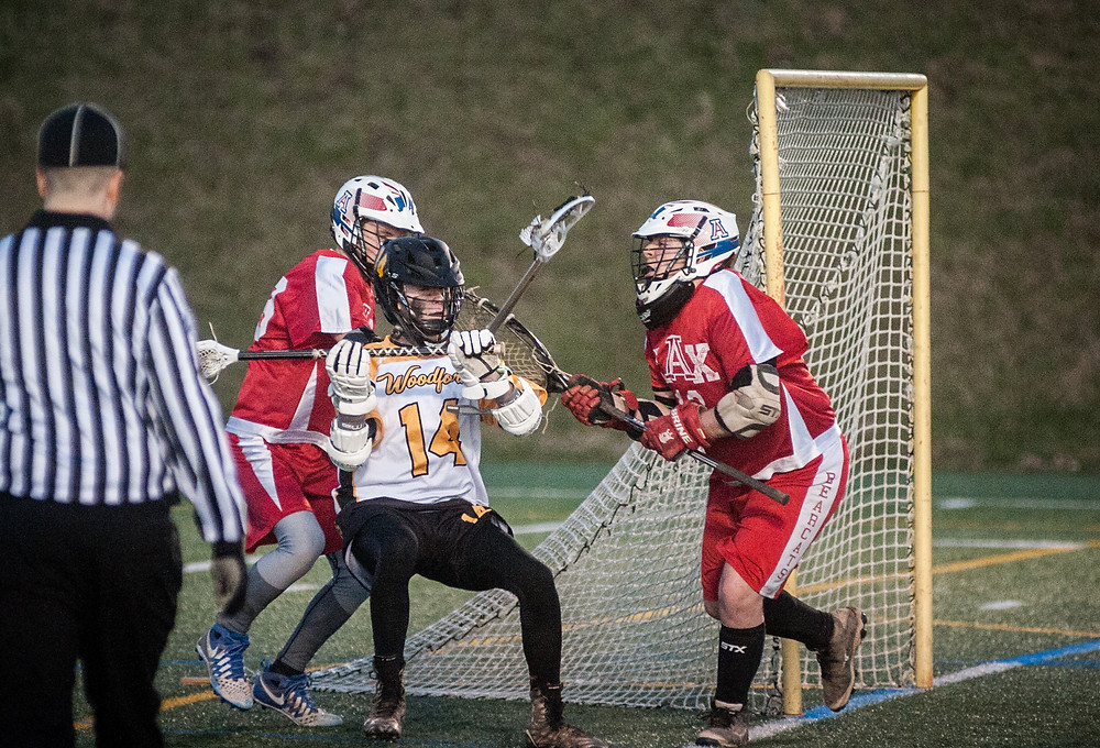 WCHS SOPHOMORE NICK CROWE, pitcured earlier this season, battles a pair of defenders near the opponents net. Crowe has scored 12 goals this season and has 12 assists. (File photo by Bill Caine)