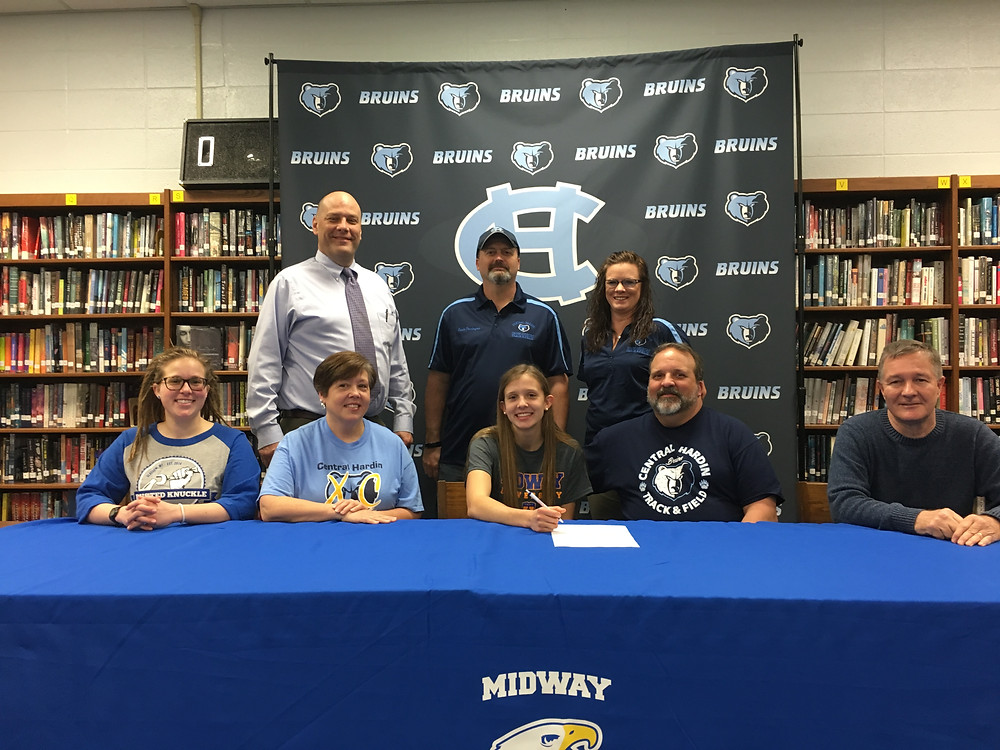 EMILY CHANDLER,middle, signed with Midway University to join their cross country team. Chandler is a senior at  Central Hardin. (Midway University photo)