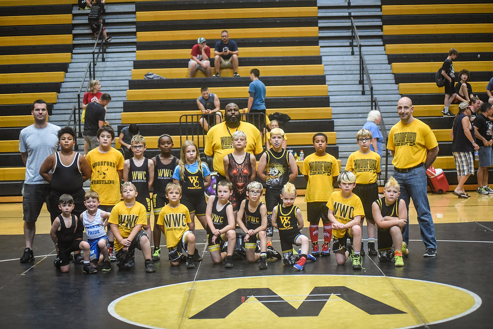 WOODFORD WRESTLING CLUB hosted its first Rookie Rumble Sunday, June 24. The event featured wrestlers with three or fewer years experience on the mat. Pictured from left: front, Cam Yost, Bryer Rogers, Aiden Tipton, JJ Escaloni, Trevor Steele, Brycen Gray, Jakob Slugantz, Landon Yost, and Israel Slugantz.; middle, Jordan Brickhouse, Jeffrey Temprano, Caleb Rogers, Nikko Strong-Walker, Dakota Tipton, Landon Wettlaufer, Gabriel Slugantz, Braylen Livingston, Maxx Escaloni; back, WWC coaches Mike Steele, Jarvis Livingston and James Escaloni. (Photo by Bill Caine)