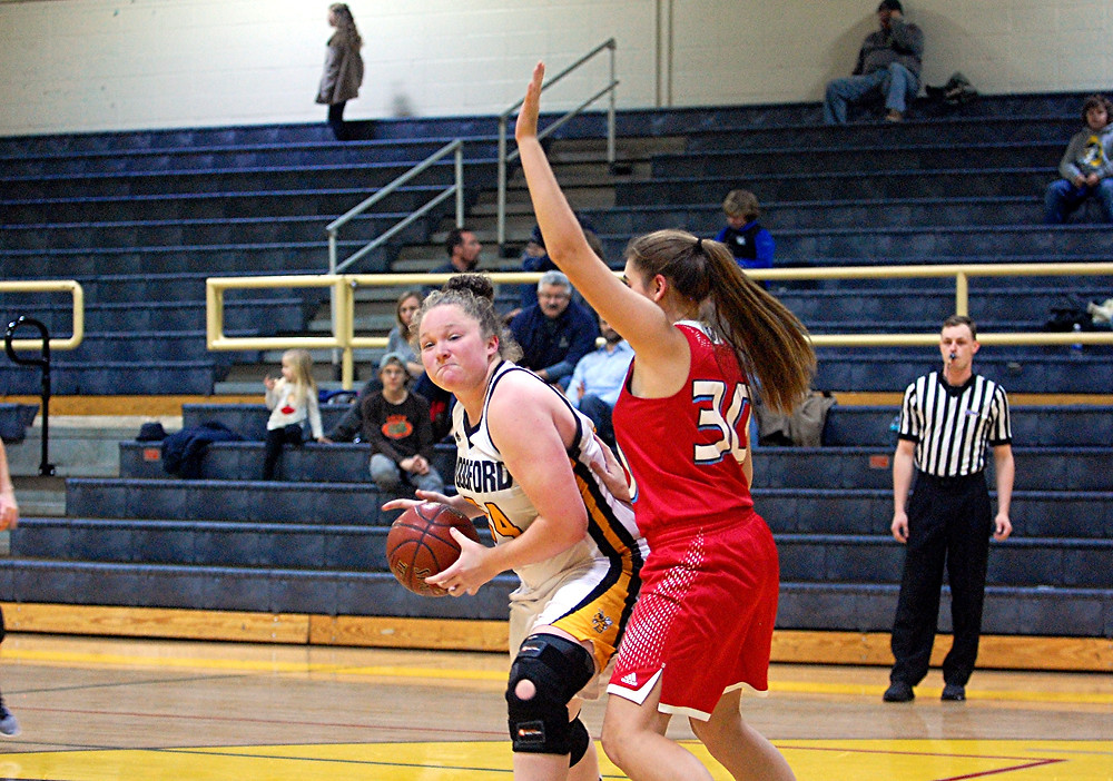 DELANEY ENLOW, left, works to get position on a West Jessamine defender to shoot the ball. The freshman forward led Woodford in the game with a double-double, as she scored 18 points and pulled down 12 rebounds. But, when the final buzzer sounded, West Jessamine had the win, 67-46. (Photo by Rick Capone)