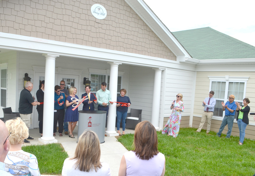 A RIBBON-CUTTING officially dedicated the new Pathway Memory Care at Daisy Hill Senior Living. Executive Director Laurie Dorough was joined by Daisy Hill staff, members of the Woodford County Chamber of Commerce and County Judge-Executive James Kay at Tuesday's event. (Photo by Bob Vlach)