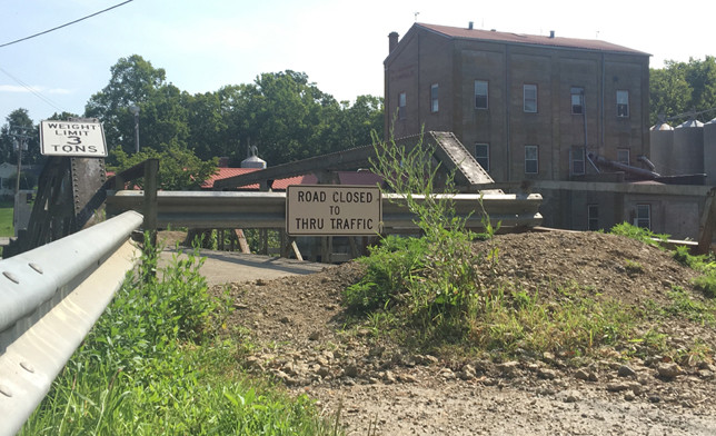 A LOUISVILLE CONSTRUCTION COMPANY submitted a winning bid of $877,000 last week to rebuild the historic one-lane Weisenberger Mill Bridge, which was closed for safety reasons July 1, 2016. (Photo by Vanessa Seitz)