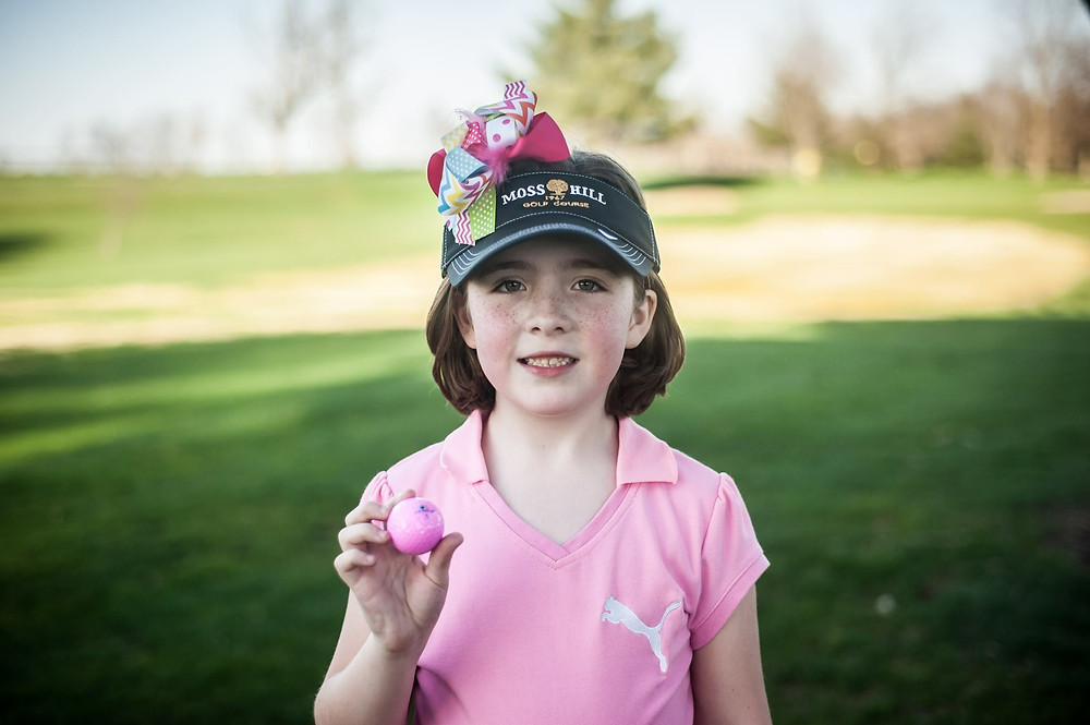 """Abigail Caine is only eight years old, but she has accomplished more in golf than some adults have in their entire careers.  In 2016, Abigail played in the seven-and-under girls' age group and won """"every single tournament except for two,"""" she said with a smile. She also won the Kentucky Junior PGA Championship and was named Player of the Year in the nine-and-under division of the tour – and she was only seven.  Abigail qualified for the 2016 U.S. Kids World Championships, which were played at Pinehurst, N.C., in August 2016. In the tournament, she finished in 28th place out of 63 players (20th among American players).  She has also qualified for the 2017 World Championships, which will once again be held at Pinehurst  in August 2017. There she will compete against golfers from around the world in her age group.  Abigail was also on the Moss Hill PGA Junior League team that won the championship last year, where """"she had a lot of fun,"""" she said.  Currently, Abigail is coached at Moss Hill by Myra Blackwelder, who has already helped her game.  """"We've only had one lesson and (I learned) a new putting stroke,"""" said Abigail. And, according to her dad, Bill, """"She dropped nine strokes in (that) one lesson from one tournament to the next.""""  This year, while Abigail could play in the eight-year-old girls' division, she has decided to play against the 12-year-old girls so she can gain more experience by playing against girls older than herself.   According to Bill,  she can hit the ball hard enough now to play from the lady's tee.  """"This one hole in particular (at Moss Hill), number 13, for the longest time, Abigail couldn't even hit her driver over it – the whole thing is a water carry – and now she can't hit her driver because (she hits the ball) 30 yards past the hole. Now she plays (the 110-yard hole with) a seven-iron, (and the ball) lands nice and soft on the green."""" And, she putts it for a birdie.  Needless to say, her parents enjoy watching Abigail play and are proud o"""